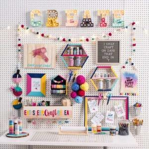 Image of creative space with bright wool, chalkboard and craft